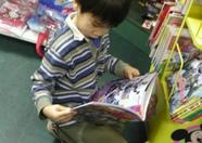 Japanese kid reading the nihon version of Mickey Mouse (Okura)