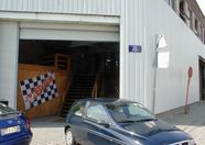 The entrance to First Kart Inn and my little car on the front