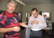 DeltaSoft's Rambi and Sunrise's Rob Hiep enjoying buttons and cake