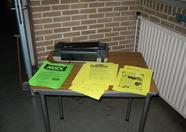 The table at the entrance with info bulletins.