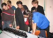 Johnny Hassink's synthesizer, and Jorrith Schaap (jorito), Yum, Rieks and Johnny Hassink studying it