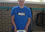 Wynke holding the penguin cake
