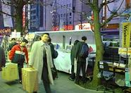 Booths offering various products can be found on the streets of Akihabara as well.