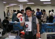 Mr. Imahi of Syntax holding Mr. Puppet