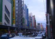 An overview of the main street of Den Den Town, Osaka.