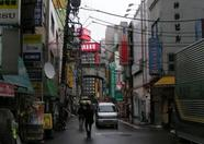 A view of one of the quieter streets of Akihabara. Of course, it had been raining and it was quite early...