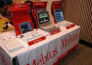 Then, lets walk around the fair, starting at the back of the ASCII stand. Sharp sponsored the fair and thus: 3 Mebius laptops running MSXPLAYer