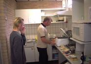 Jeroen observing Gerard's cooking skills