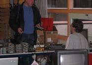Bas helping out people with hardware questions and selling nice items