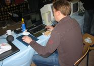 Richard Cornelisse (Huey) working at the Trilobyte booth.