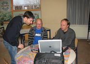 Alex Wulms, Jos van den Biggelaar (Yobi) and Marcel Delorme (msd) discussing the software for the DenYoNet cartridge.