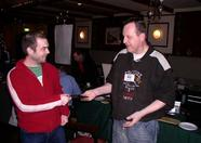 Vincent Van Dam receiving the first prize to the Bombaman Level Edit Challenge: A Sunrise Game Reader.