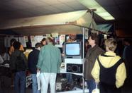 People looking at game demonstrations of Arcus and Space Manbow.