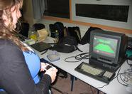 Maartje playing Penguin Wars 2 on a Dingoo running openMSX